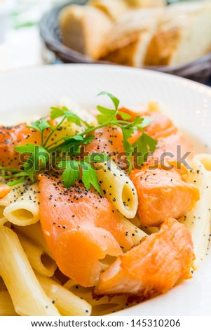 tasty pasta with salmon on a the table