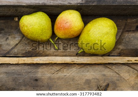 Tasty pears on the old wooden background - stock photo