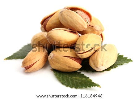 tasty pistachio nuts with leaves, isolated on white