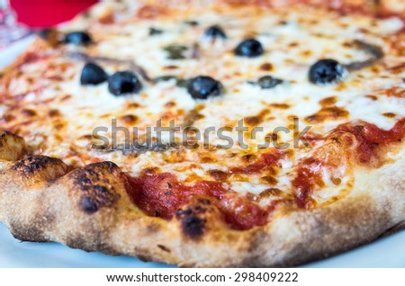 tasty pizza on a the table - stock photo