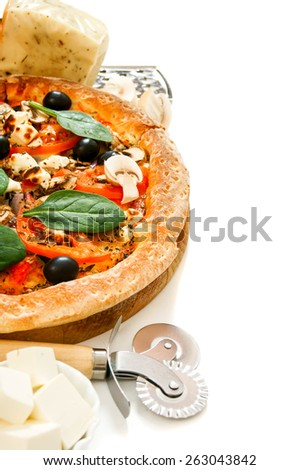 Tasty pizza on a white background. Veggie a pizza with ingredients. - stock photo
