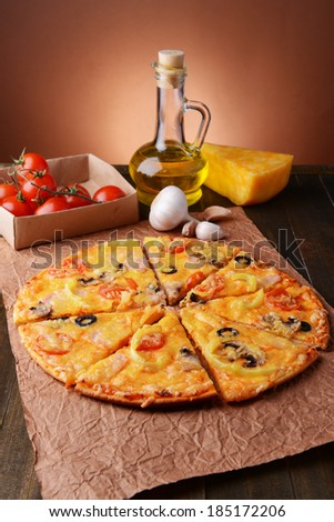 Tasty pizza on table close-up - stock photo