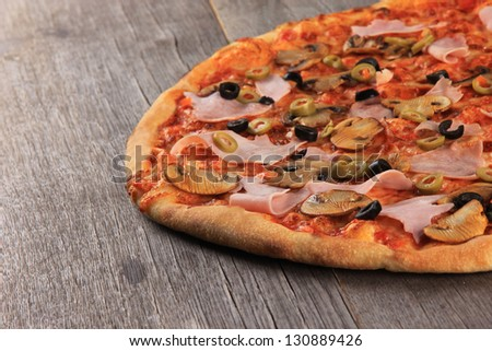 Tasty pizza on wooden background
