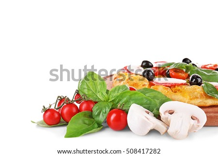 Tasty pizza with mushrooms, branch of cherry tomatoes, olives and basil on wooden board and white background