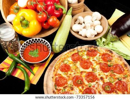 Tasty pizza with salami and pepper - stock photo