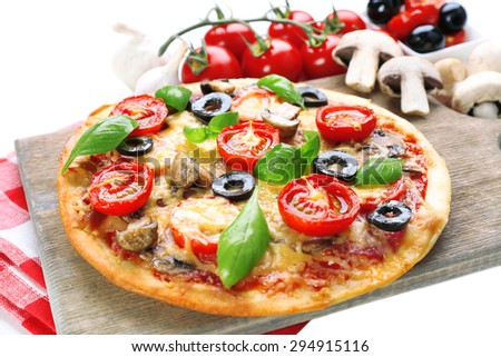 Tasty pizza with vegetables and basil close up - stock photo