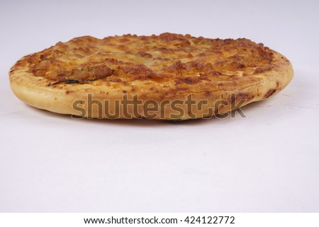Tasty pizza with vegetables and chicken  isolated on white. DOF and copy space - stock photo