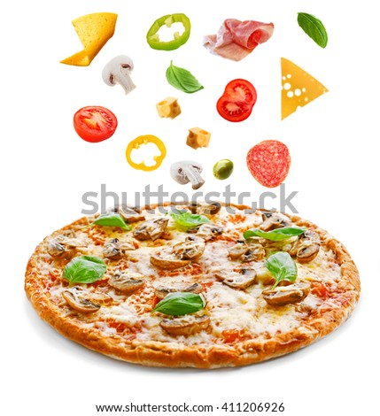 Tasty pizza with vegetables and falling ingredients isolated on white - stock photo