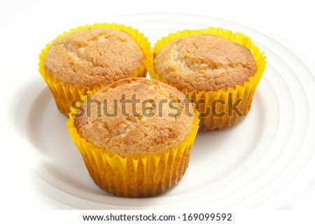 Tasty Plain Muffin Cakes on a white background - stock photo