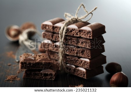 Tasty porous chocolate with nuts on table, close up - stock photo