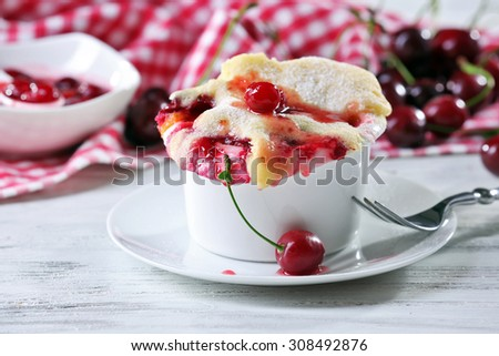 Tasty pudding with cherries on table close up - stock photo
