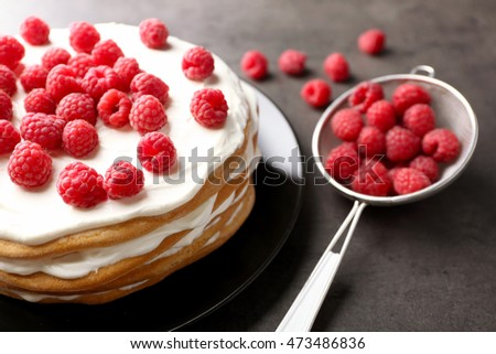 Tasty raspberry cake on grey background, closeup