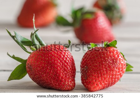 Tasty red strawberries on a wooden table