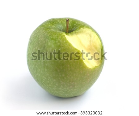 Tasty ripe green nibbled apple on a white background closeup - stock photo