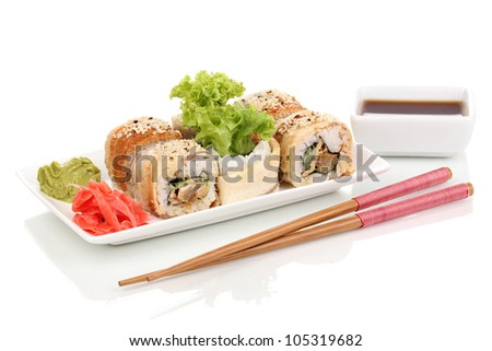 Tasty rolls served on white plate with chopsticks isolated on white - stock photo