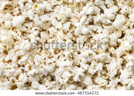 Tasty salted popcorn. Top view.