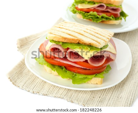 Tasty sandwiches with ham, isolated on white - stock photo
