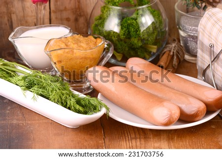 tasty sausages with parsley and milk - stock photo