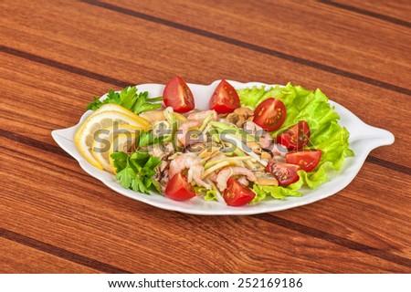 Tasty seafood salad with vegetable - stock photo