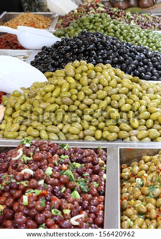 tasty seasoned olives for sale at vegetable market directly from producer to consumer - stock photo
