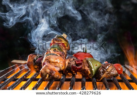 Tasty skewers on garden grill. - stock photo