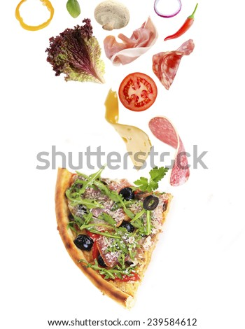 Tasty slice of pizza and falling ingredients isolated on white - stock photo