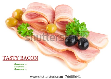 Tasty sliced pork bacon with parsley and black and green olives isolated on white background - stock photo