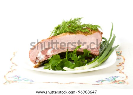 Tasty smoked meat with dill on a white background