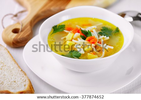 Tasty soup on a wooden table.
