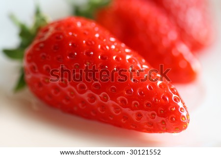 Tasty strawberries. Shallow depth-of-field. - stock photo