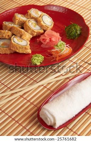 Tasty sushi prepared at japanese restaurant. - stock photo