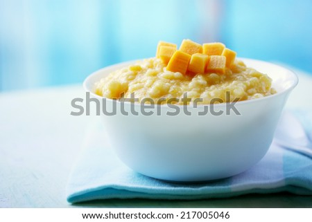 Tasty sweet milk porridge pumpkin, healthy food - stock photo