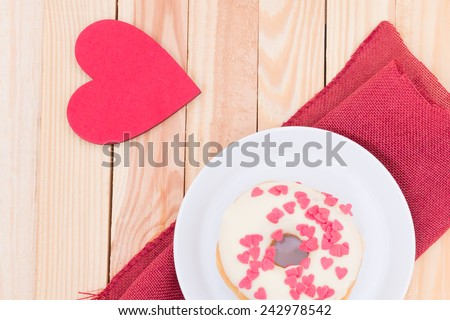 tasty sweets - heart donut - white donut with red sugar hearts and red heart for decoration - stock photo