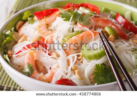 Tasty Thai salad yam woon sen with seafood macro in a bowl. horizontal - stock photo