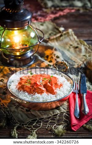 Tasty tikka masala with chicken in tomato sauce - stock photo