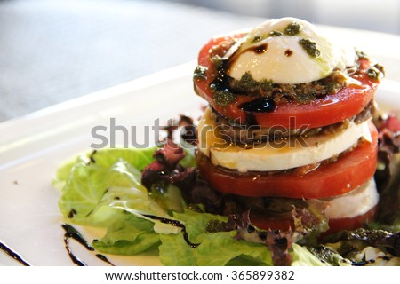 Tasty tower. Meat salad. Salad with beef, egg and fresh tomatoes. Tasty. Delicious. Spicy. Fragrant. - stock photo