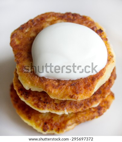 Tasty Ukrainian nutritious cottage cheese dish. Perfect homemade breakfast is always cottage cheese pancake - delicious and healthy. - stock photo