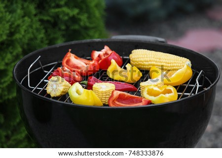 Tasty vegetables cooking on barbecue grill, outdoors