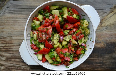 Tasty vegetarian salad with tomatoes and cucumber - stock photo