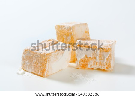 Tasty yellow cubes of turkish delight - stock photo