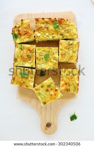 Tasty zucchini and cheese slice. Top view - stock photo