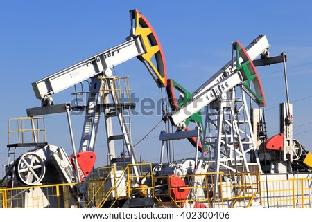 Tatarstan, Russia - August 15, 2015: Oil pumps in the field on a background of blue sky.