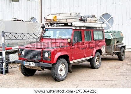 TATARSTAN, RUSSIA - AUGUST 20, 2011: Purple Land Rover Defender travel car at the interurban road. - stock photo