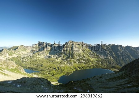 Tatra Mountains and ponds in the valley. - stock photo