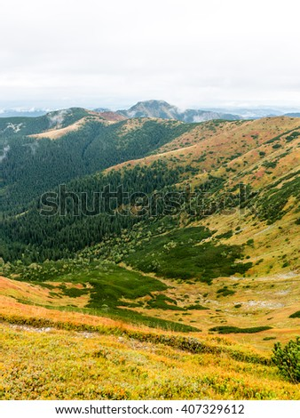Tatra mountains in Slovakia covered with clouds. autumn colors.