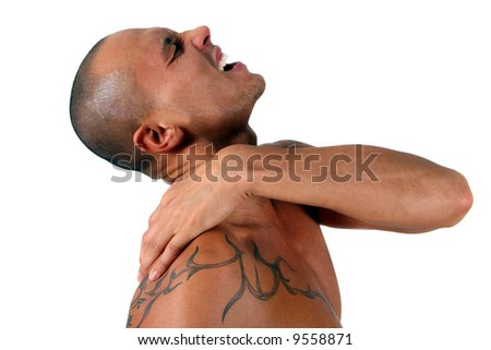 Tattoo And Pain A young man holds his shoulder in severe pain. Isolated over white! - stock photo