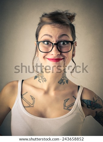 Tattooed girl smiling  - stock photo