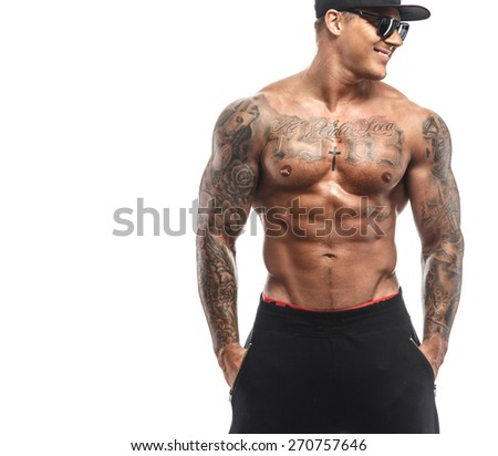 Tattooed man with naked muscular torso isolated on white - stock photo