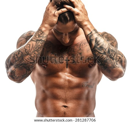 Tattooed muscular guy posing in studio. Isolated on white background - stock photo