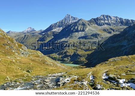 Tauernmos lake (Tauernmossee) and mountains Totenkopf, Hohe Riffel and Hocheiser. National park Hohe Tauern, Austrian Alps, Austria - stock photo
